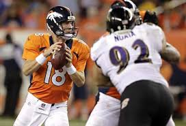 Manning looking to hit a receiver downfield.